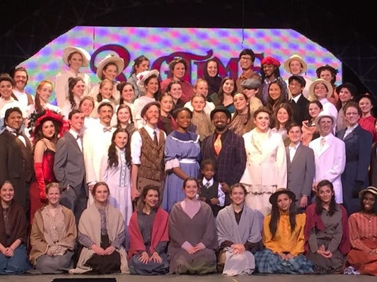 'Ragtime' cast members pose on stage Thursday at Cherry Hill High School East.