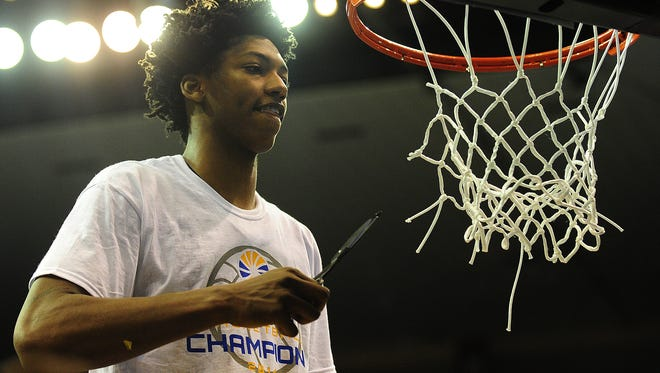 UL guard Elfrid Payton (2) ceremonially cuts a piece of the net after the Ragin? Cajuns knocked off No. 1-seeded Georgia State 82-81 in overtime to win the Sun Belt title and qualify for the NCAA Tournament for the first time since 2005.  Paul Kieu/The Advertiser UL Ragin Cajuns guard Elfrid Payton (2) ceremonially cuts a piece of the net after the team defeated the Georgia State Panthers 82-81 with overtime in the Sun Belt Conference basketball championship game at the Lakefront Arena in New Orleans, LA, Sunday, March 16, 2014.    Paul Kieu, The Advertiser