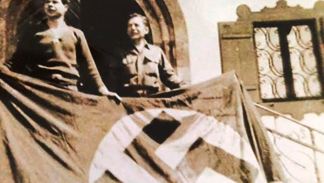 Bill Davis (left) at Berchtesgaden. The soldiers were allowed to take items from there when they left.