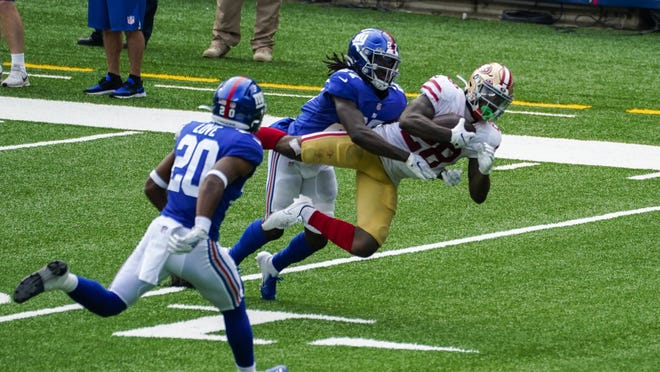 Former Doherty High star Isaac Yiadom, shown tackling San Francisco running back Jerick McKinnon in a game last week, has started to settle into the New York secondary since being traded to the Giants during training camp.