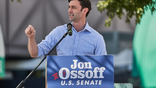 U.S. Senate candidate Jon Ossoff addresses a crowd at a drive-in rally at the James Brown Arena parking lot in Augusta GA, Friday November 13, 2020.