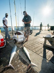 Jamal Jones, of Navarre, left, and Brandon Carr, of Milton, pack up their gear after catching some King Mackerel on the fishing pier in Navarre Beach on Monday, November 6, 2017.  Santa Rosa County is expected to approve a contract with Growing Santa Rosa Enterprises LLC to run the Navarre Beach Pier starting on December 1, 2017.