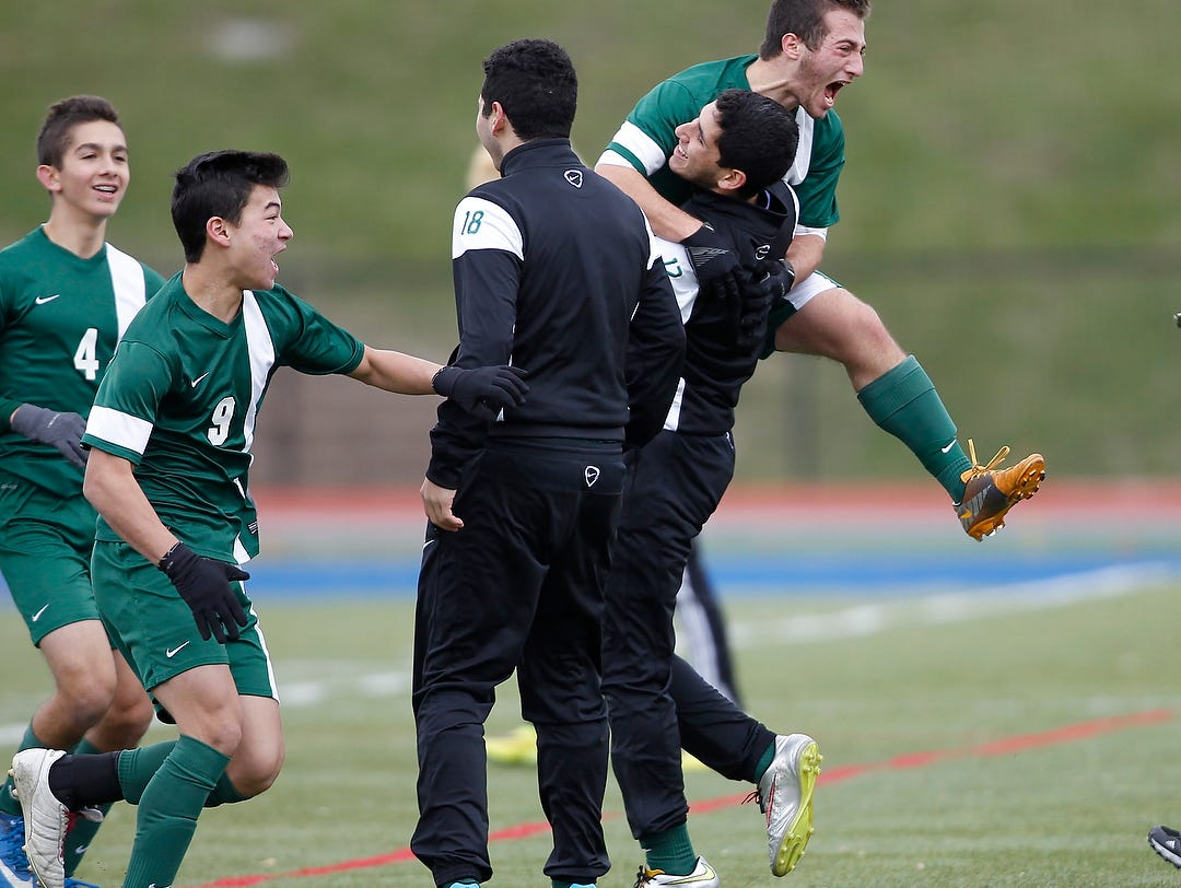 Solomon Schechter's Jacob Richman (5) center reacts to their their 1-0 win over Geneseo in the NYSPHSAA Class C state semifinal soccer game at Middletown High School on Saturday, Nov. 14, 2015.