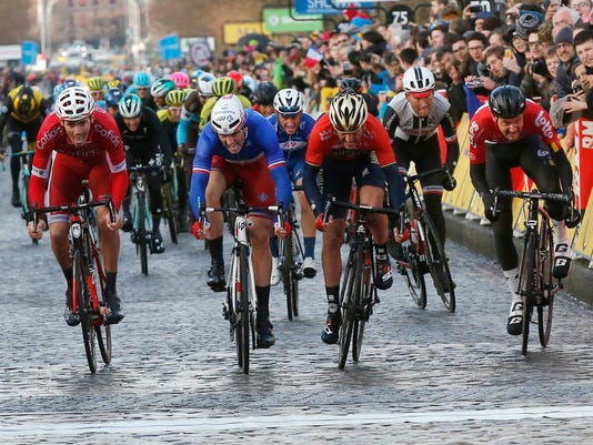 French Arnold Demare, 2nd left crosses the finish line to win the 1st stage of the Paris Nice cycling race ahead of Spanish Gorka Izaguirre Insausti, 2nd right, French Christophe Laporte, left, and Belgian Tim Wellens,right, between Chatou and Meudon, outside Paris, Sunday, March 4, 2018. (AP Photo/Michel Euler)