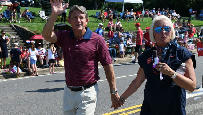 Republican gubernatorial candidate Randy Boyd and his wife, Jenny, appear in the Town of Farragut's 31st annual Independence Day parade on July 4, 2018.