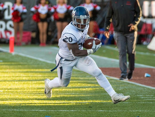 Nevada Wolf Pack running back James Butler (20) runs