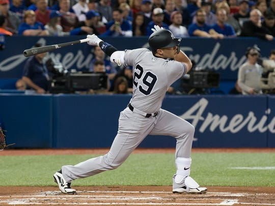 New York Yankees third baseman Brandon Drury (29) hits a double against the Toronto Blue Jays to score catcher Gary Sanchez (not pictured) during the second inning at Rogers Centre.