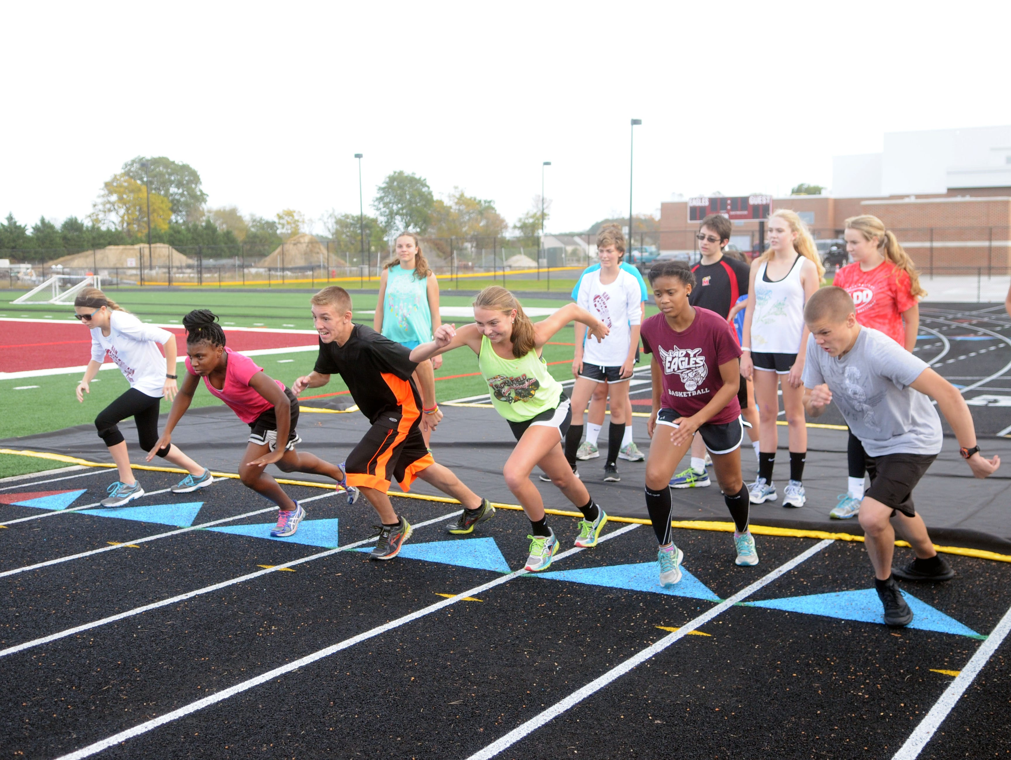The Snow Hill boys and girls cross country team practice sprints on Wednesday.