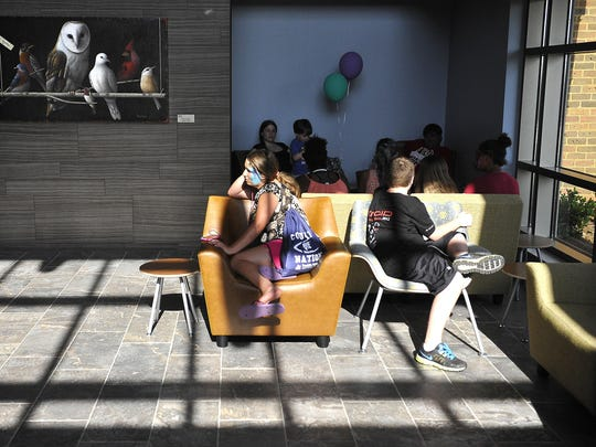 Children take a break inside the lobby at the Monroe Carell Jr. Children's Hospital Vanderbilt at Williamson Medical Center, which offered tours on Wednesday. The facility opens July 1 in Franklin.