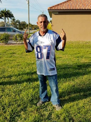 """Anthony """"Tony"""" Pimentel died Friday, June 1, while working construction in Cape Coral. He was 53. He is shown here wearing a Rob Gronkowski New England Patriots jersey."""