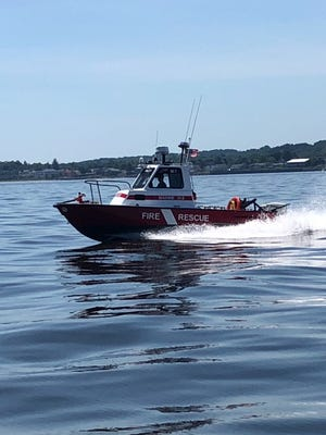 A fire company marine unit transported two kayakers to shore after their kayak turned over.