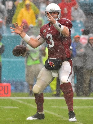 Arizona Cardinals quarterback Carson Palmer (3) loses control of the ball against the Miami Dolphins during the second half at Hard Rock Stadium. The Miami Dolphins defeat the Arizona Cardinals 26-23.