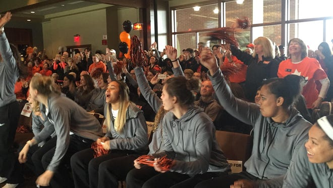 Oregon State women's basketball players and fans celebrate the Beavers' bid to the NCAA tournament on Monday.