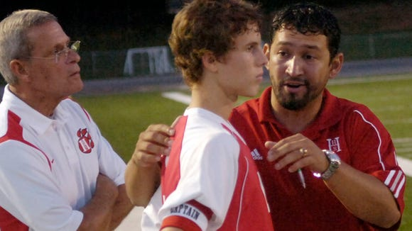 Freddy Oviedo, right,, has resigned as Hendersonville's boys and soccer coach.