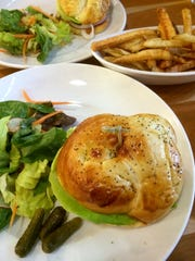 Burger night at South End Kitchen on Pine Street, where burgers are served on a house-made challah bun with salad or fries. Kids get a milk shake with their burgers, adults can get a beer. Burger and a salad with a Zero Gravity beer is $15.