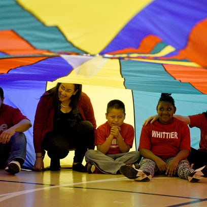 Whittier Elementary students hid under a parachute
