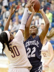 The Lebanon Catholic Beavers were denied a League title Thursday night at Mannheim Township High School by the Crusaders from Lancaster Catholic. Lancaster Catholic topped the Lebanon Catholic girls team 59-49. Neesha Pierre is pushes through a Crusader to score two in the final moments of the League Championship game.