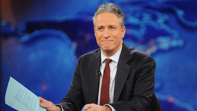 "This Nov. 30, 2011, photo shows television host Jon Stewart during a taping of ""The Daily Show with Jon Stewart"" in New York."