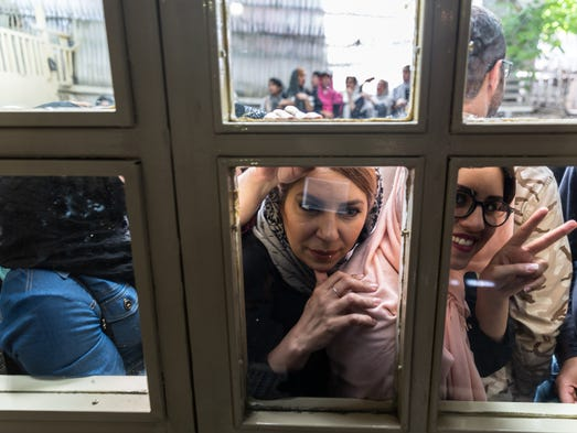Voters in Tehran wait to expel their ballots in the
