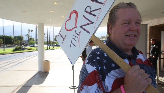 Bob Richmond protested outside Palm Springs City Hall on September 7, 2016, over the council's proposed gun control ordinance.