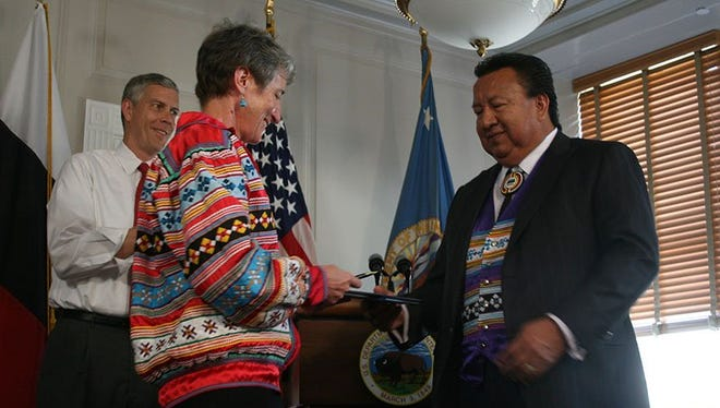 Interior Secretary Sally Jewell presents Miccosukee Chairman Colley Billie  with the waiver of No Child Left Behind Act requirements for the Florida tribe' s school. The first such agreement with a tribe in the nation.