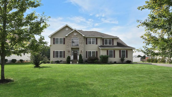 This six-bedroom home has an updated kitchen, oversized two-car garage and a finished basement.