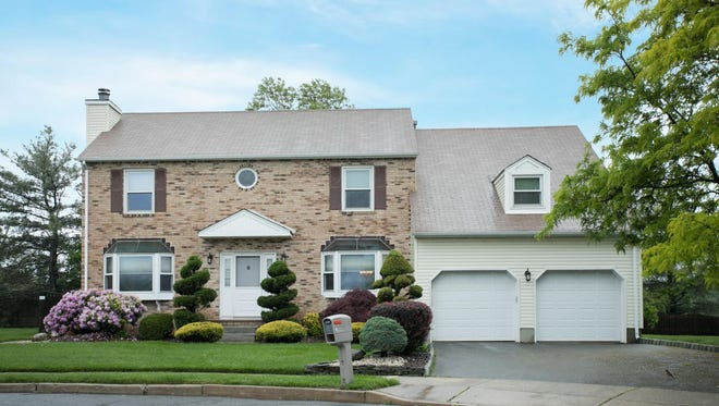 This four-bedroom Colonial at 6 Regal Court in Royal Brook Estates will be open 1 to 4 p.m. Sunday, June 4.