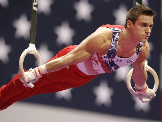 Sam Mikulak works the rings during the American Cup