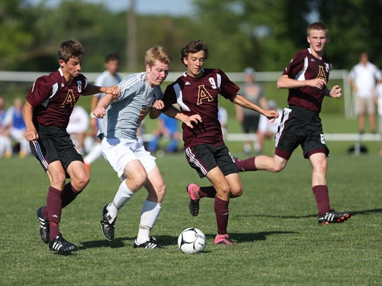 Valley's Mark Broderick tries to get the ball past