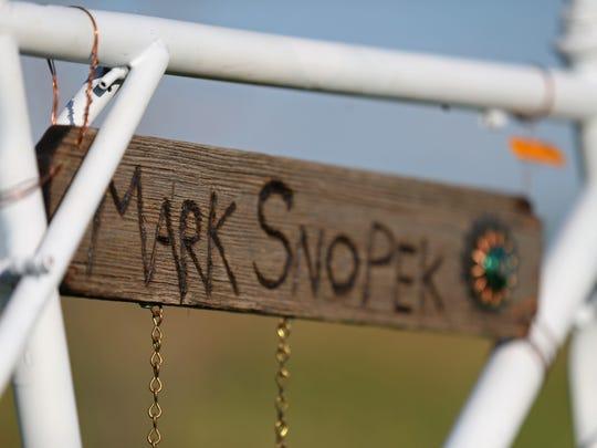 A ghost bike honoring the life of Mark Snopek is installed