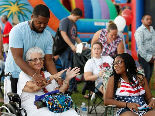 Maurice Williams chair dances with aunt Sally Dick at Cape Coral's Red, White & Boom celebration Monday.