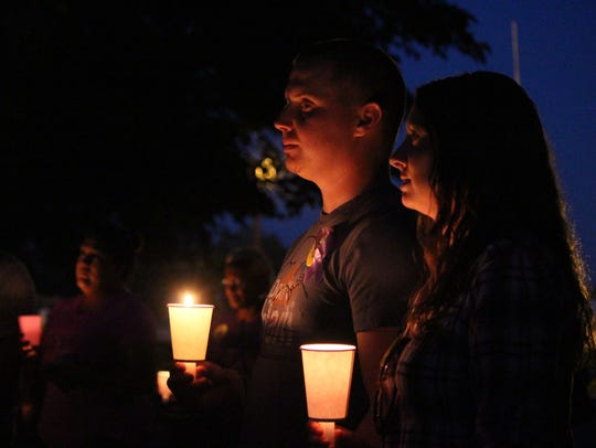 Wednesday's candlelight vigil  brought members of the