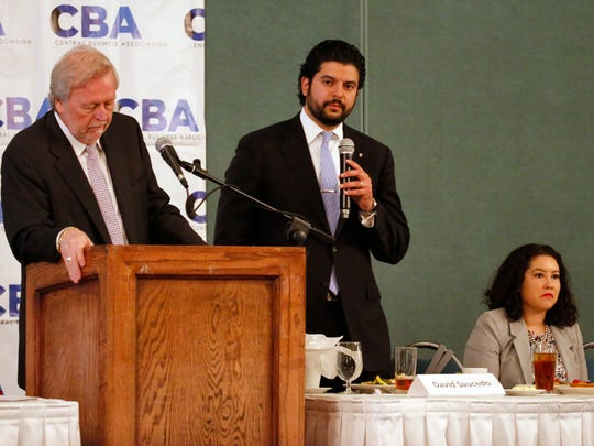 Mayoral candidates David Saucedo, center, and Elisa Morales, right, address a Central Business Association luncheon.