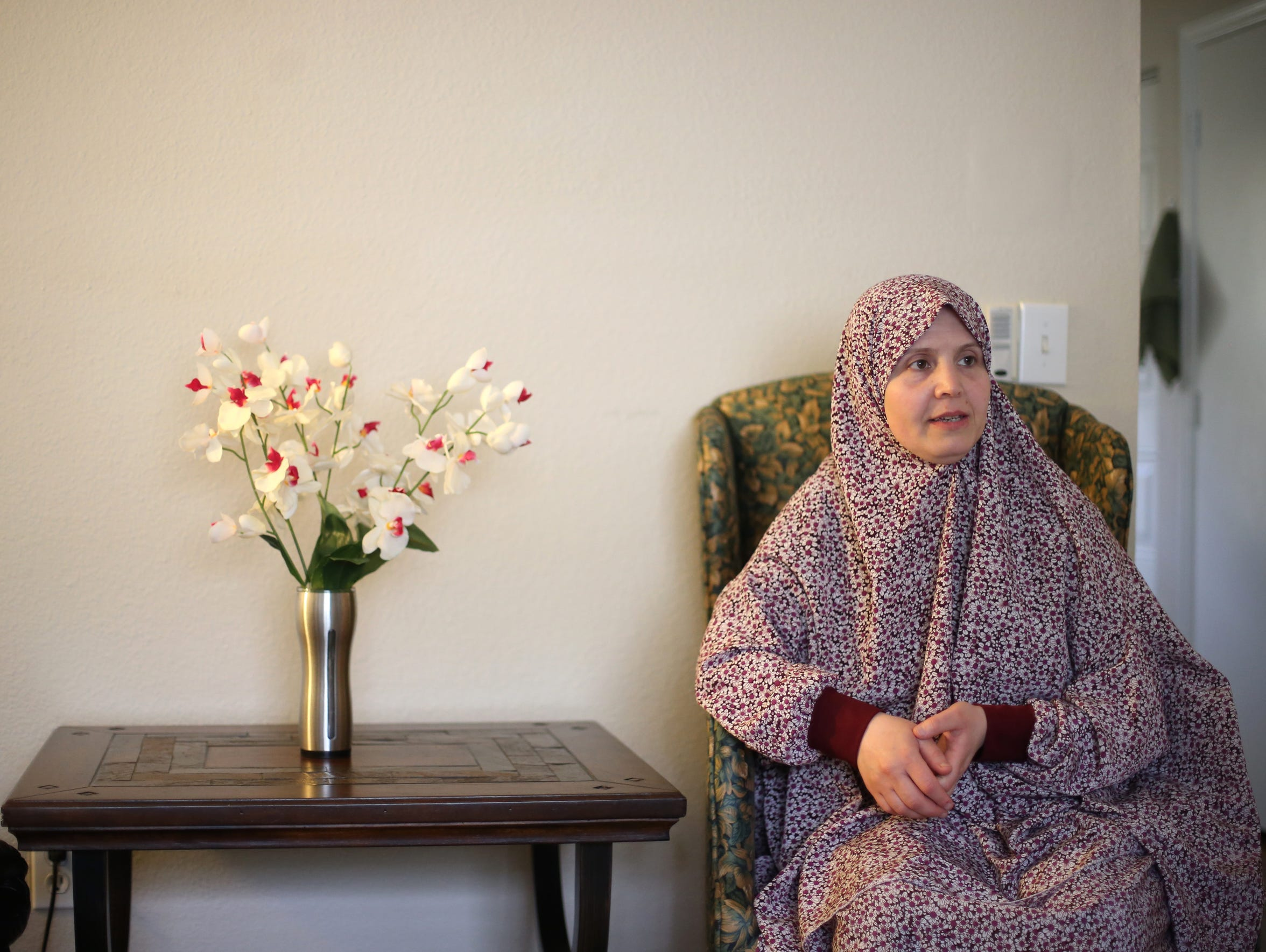 Emein Alhendi sits in the living room of her Tallahassee