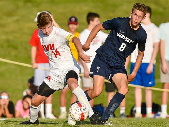 Champlain Valley Union's Nate Coffin, left, foots the
