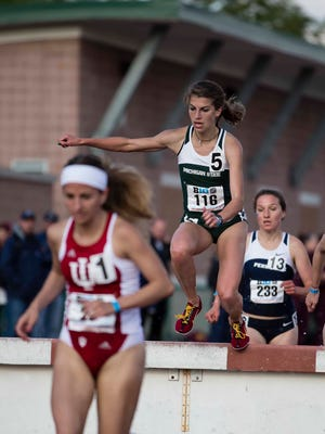 MSU senior Katie Landwehr (116) leaps over the water barrier during a 3,000-meter steeplechase race this spring. She will compete in the event at the NCAA Outdoor Track and Field Championships this week in Eugene, Oregon.
