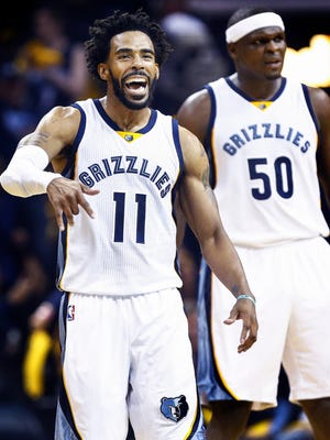 Memphis Grizzlies guard Mike Conley celebrates a made 3-pointer while being fouled by San Antonio Spurs during second quarter action in the fourth game of their NBA first round playoff series at the FedExForum.