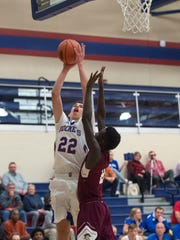 Spring Grove's Elijah Taylor (22) goes up for a layup over New Oxford's Abdul Jenneit, Tuesday, Dec. 19, 2017. The New Oxford Colonials topped the Spring Grove Rockets, 54-48.