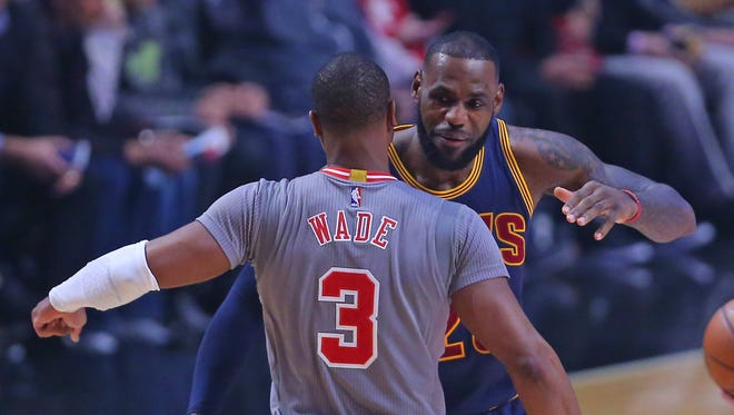 Chicago Bulls guard Dwyane Wade (3) and Cleveland Cavaliers forward LeBron James (23) meet at half court prior to the first quarter at the United Center.