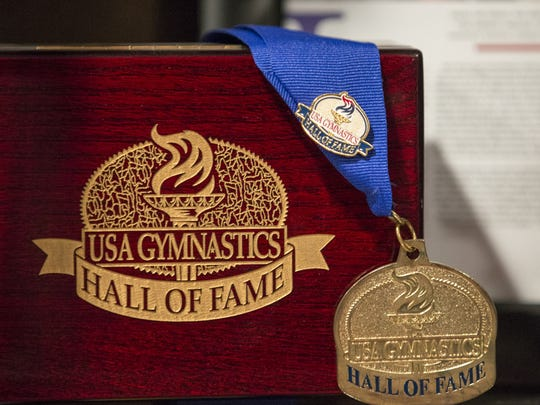 A USA Gymnastics Hall of Fame medal, given to Dominique Moceanu, who won gold with her team in Atlanta, 1996, at her home in Hinkley, Ohio, Wednesday, Feb. 22, 2017. Moceanu is an advocate for gymnasts and seeks reform in the ways the governing body deals with abusive support personnel.