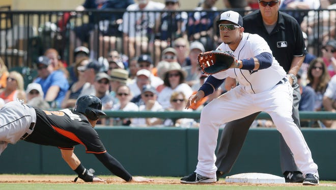 Detroit Tigers first baseman Miguel Cabrera waits on the throwback as Miami Marlins' Reid Brignac jumps back to first during the first inning of a spring training exhibition baseball game in Lakeland, Fla., Wednesday, March 25, 2015.