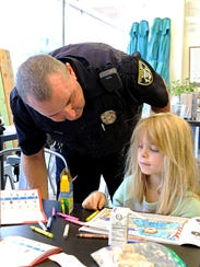 Wichita Falls police officer Kyle Cook (left) talks