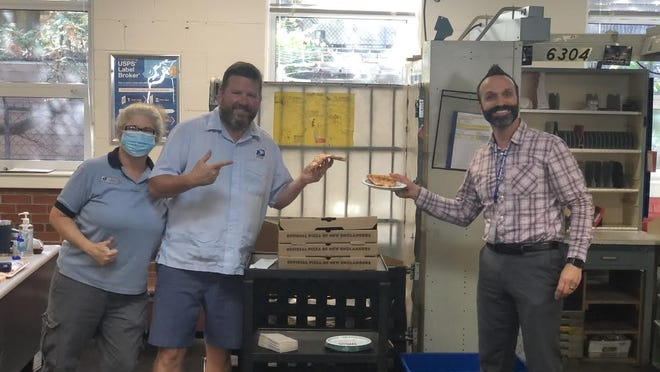 Papa Gino's donates lunch to the staff of the North Chelmsford Post Office as part of its ongoing donation program.
