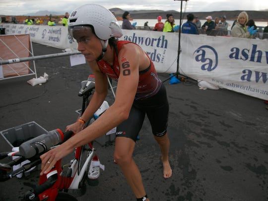 Ironman 70.3 St. George participant and past winner Heather Wurtele grabs her bike and head out of the transition area between the swim and bike portions of the course Saturday, May 7, 2016.