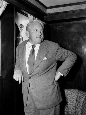 Actor Spencer Tracy poses in his cabin aboard the Queen Mary after his arrival in New York City on June 13,1951 after a pleasure trip in Europe.