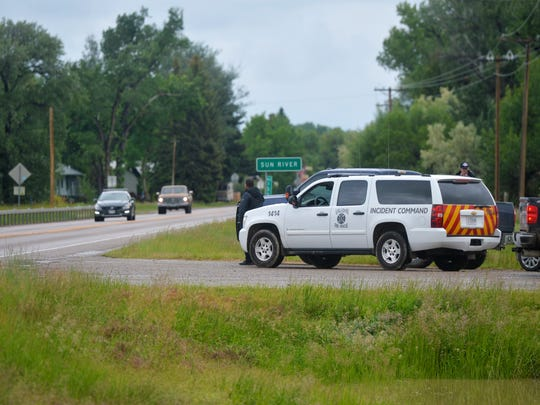 Emergency responders stage on Highway 200 Tuesday afternoon in anticipation of closing the Highway due to Sun River flooding in the town of Sun River. The Sun River is expected to crest at 10.1  feet on Tuesday night.
