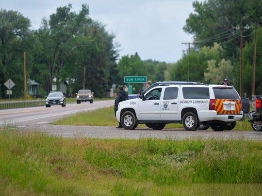 Emergency responders stage on Highway 200 Tuesday afternoon