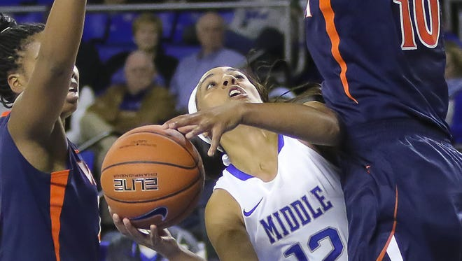 MTSU guard Brea Edwards attempts a shot over a Virginia defender Friday night at the Murphy Center. Edwards finished with a career-high 30 points in the Lady Raiders' 70-66 loss.