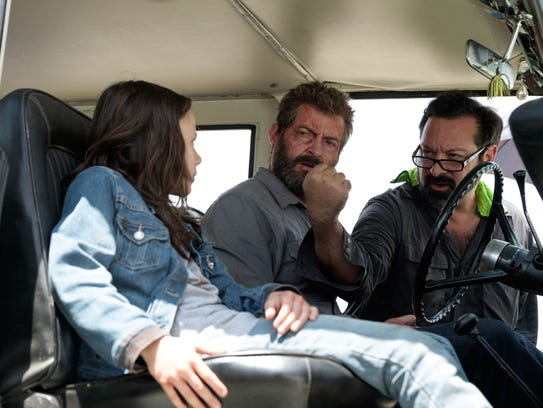 'Logan' director James Mangold (right) goes over a