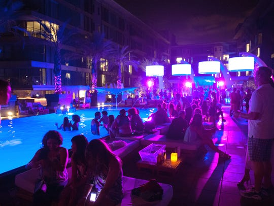 Guests enjoy a pool party at the W Scottsdale Hotel.